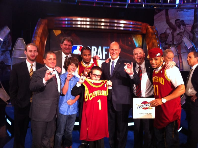 Dan Gilbert Has The Strangest Entourage In The NBA
