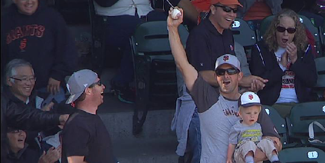 Man Catches Foul Ball While Holding Baby