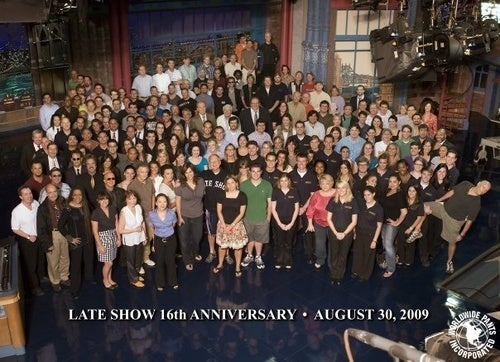 Assistant in Question Gets Place of Honor in Late Show Staff Photo