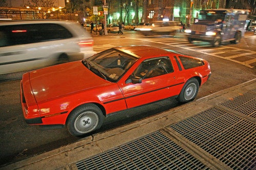 Red DeLorean DMC-12 Down On The New York City Street