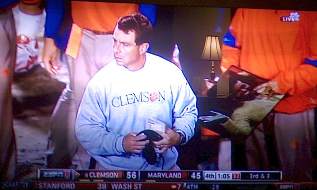 Why Yes, It Does Look Like A Clemson Coach Had A Michelle Obama Trapper Keeper On The Sidelines