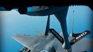 Badass photo of an F-15 refueling