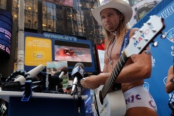 The Naked Cowboy Attempts Shakedown of Naked Cowgirl, Starts Naked Times Square War
