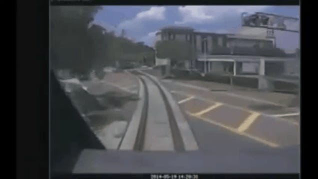 Woman Slips Out of Her Car Just Before an Oncoming Train Totals It