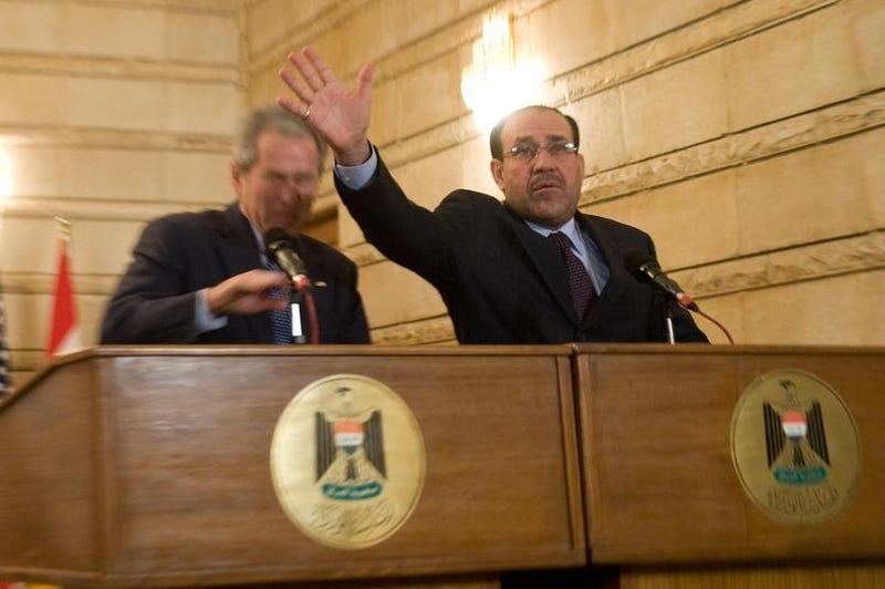 Bush Comes Under Shoe Attack in Baghdad