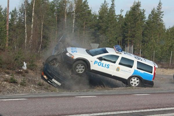 Volvo Police Wagon Flips, Mounts Fleeing Audi