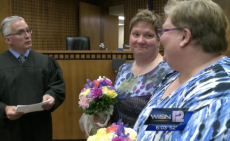 Bigoted Old Fart Can't Faze These Women Getting Married