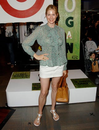 Kelly Rutherford looked equestrian chic in flat brown boots. She paired the shoes with low
