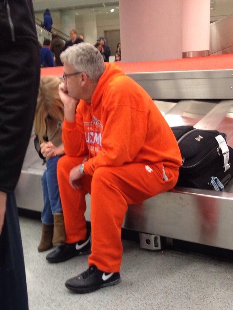 Rex Ryan Waits In Airport, Wears All-Orange Sweatsuit