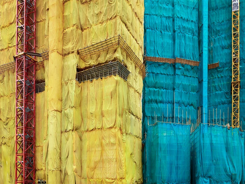 The Surreal Sight of Skyscrapers Encased in Colored Fabric