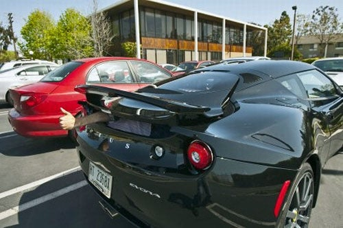 Road&Track Crams Adult Human Into Lotus Evora Trunk