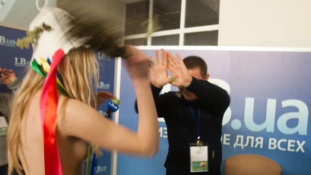 Bare-Breasted Ladies Of FEMEN Beat Ukranian Execs With Branches