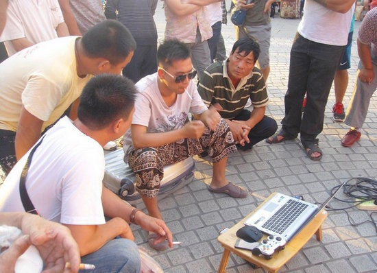 Rich Chinese Man Shows Off At Train Station with Video Games