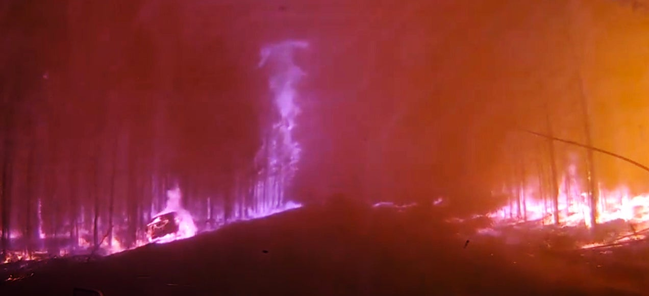 Extremely scary video of car driving right across a forest fire