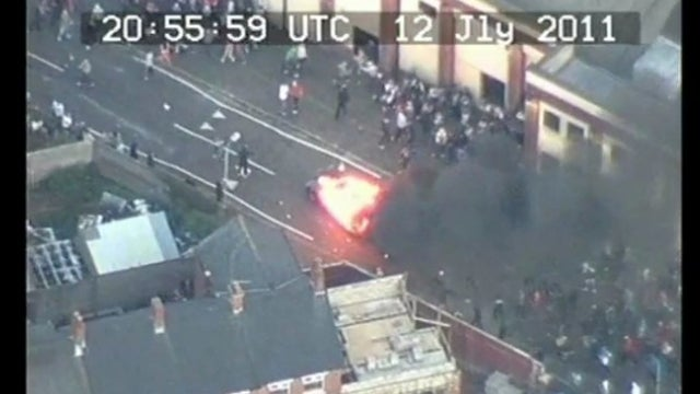 Watch protesters lose control of a fiery battering ram