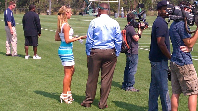 Ines Sainz Showed Up To Jets Practice Today In Four-Inch Heels And An Azure Cocktail Dress