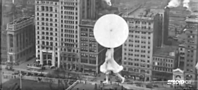 Lady dances on a tightrope 300 feet above NY without any safety—in 1931!