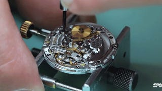 Watchmaker takes apart and reassemb