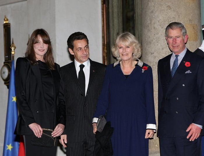 "Bruni & Sarkozy Bid ""Bonjour"" To Camilla & Charles"
