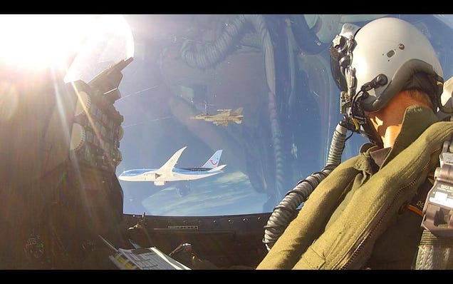 Extremely rare photo of two armed F-16s escorting a Boeing Dreamliner