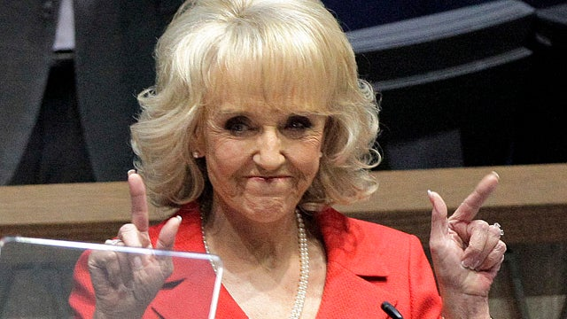 Did Jan Brewer Punch a Reporter for Asking Her about Global Warming?