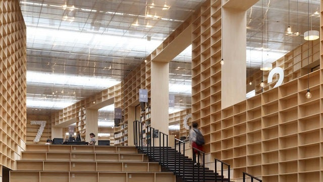 A Towering Temple of Bookshelves for Books and Readers