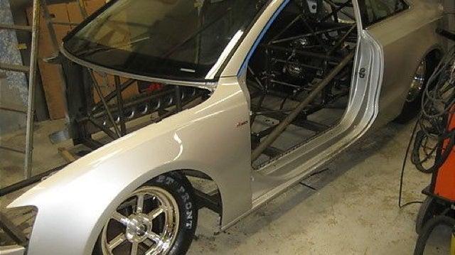 Watch an Audi A5 transform into a drag car