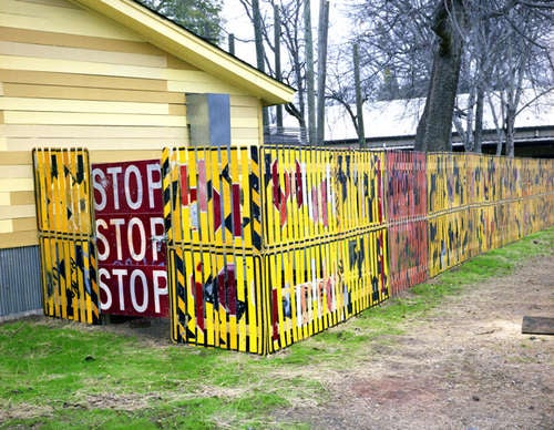 A Fence Made from Road Signs