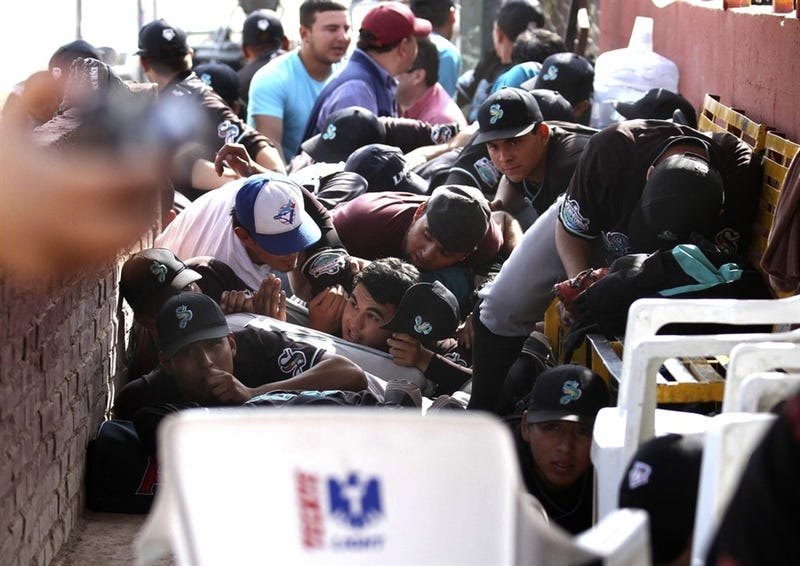 This Is What It Looks Like When A Baseball Team Takes Cover During A Gunfight