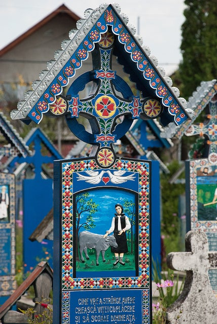 In the world's most cheerful cemetery, the tombstones are brightly painted and jokes are written on the graves