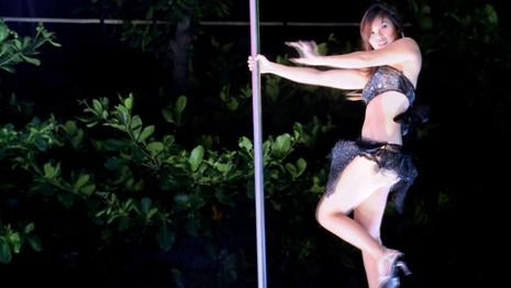 Taiwan's funeral strippers dance for a dead crowd