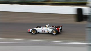 Vintage Indy 500 Race Cars Lapping At Speed