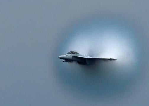 An FA-18 Emerges From A Transdimensional Wormhole Over Detroit