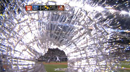 TV Cameraman Keeps Filming After A Baseball Bat Smacks His Gear
