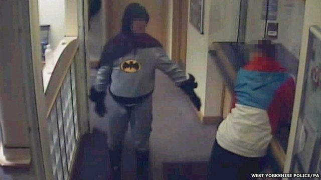 A Man Dressed As Batman Brought a Suspect into Custody