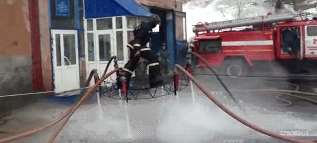 Fireman flies using water hoses