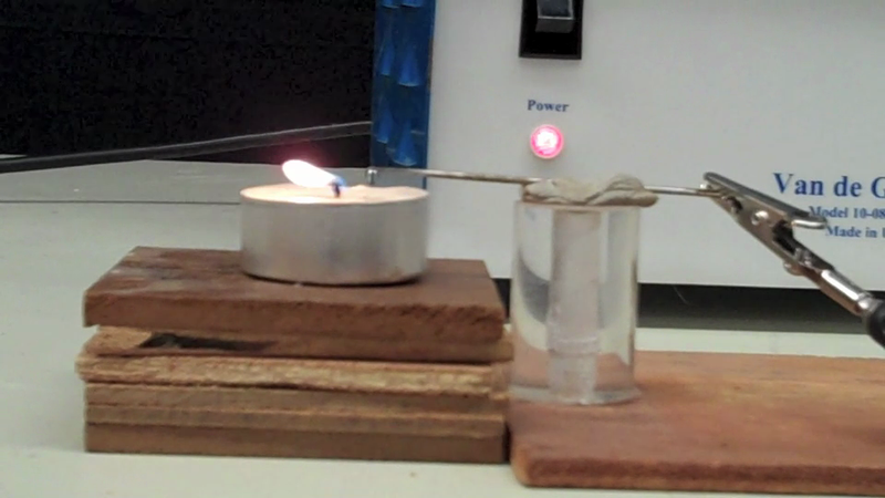 """A Van de Graaff generator can snuff out a candle with """"electric wind"""""""