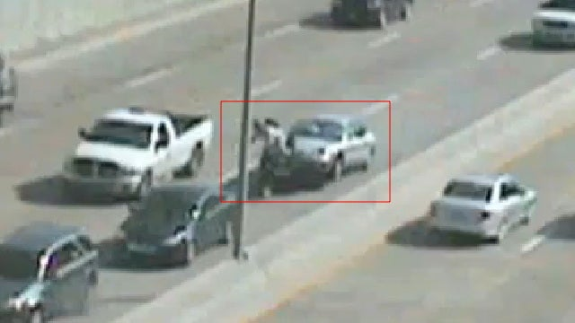Chilling video shows motorcyclist crushed between cars
