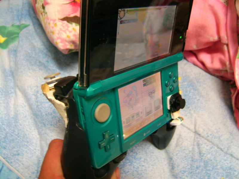 A 3DS Modded with a PSP Thumb Pad. What Do You Think?