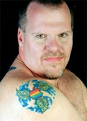 12 Idiots With Hideous and Stupid Apple Tattoos