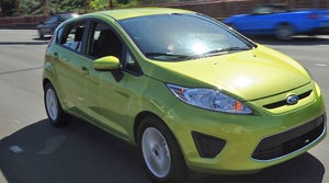 Ford Sync plays catch-up with OnStar, hatches are hot, and a smaller lux-Pug