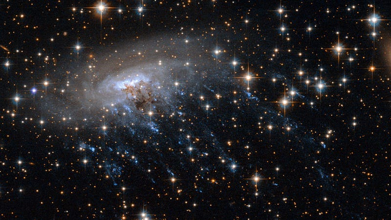 Haunting new Hubble image shows a galaxy being ripped to shreds