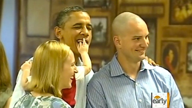 Adorable Baby Shoves His Fingers Into Obama's Mouth