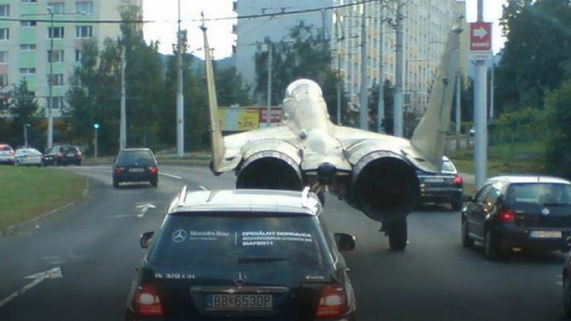 Yes, That's A MiG Fighter Jet Driving Down A Busy Street