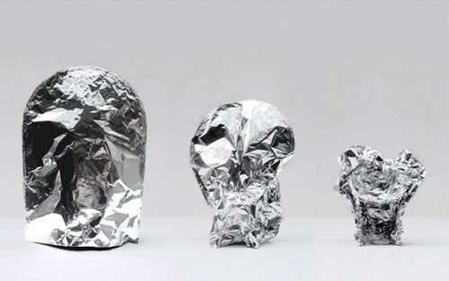 Aluminum Foil Chair Clings To You Like Foil On Day-Old Leftovers