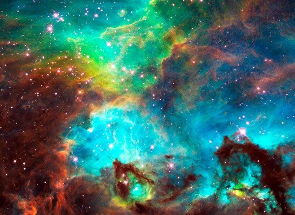 Birthing Stars Tear Into A Nebula With A Fierce Beauty