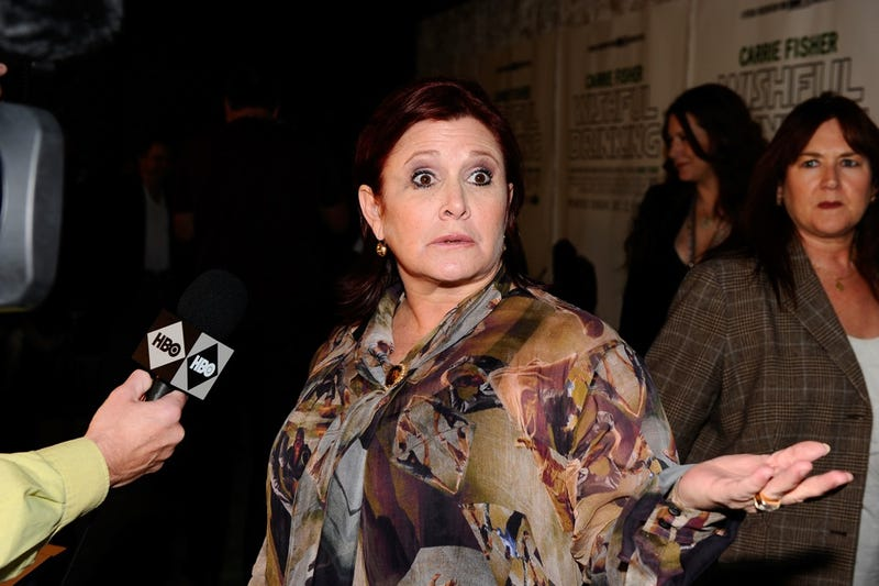 Carrie Fisher Tells John Travolta It's OK to Be Gay