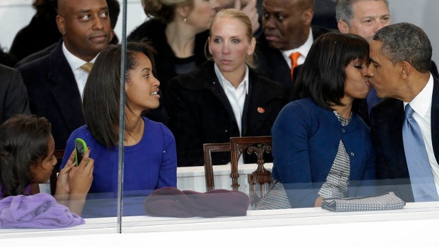 Barack and Michelle Obama Sneak a Smooch in Adorable Inauguration Parade Photo (UPDATE: GIF!)