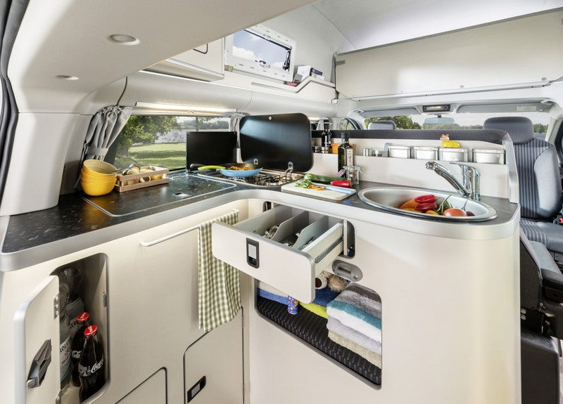 This Ingeniously Packaged Camper Packs Four People In A Tiny Van