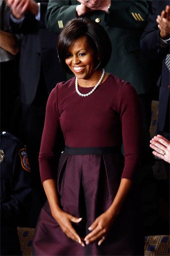 Michelle Wears Mizrahi & McQueen; Juicy Founders Sour On Fashions